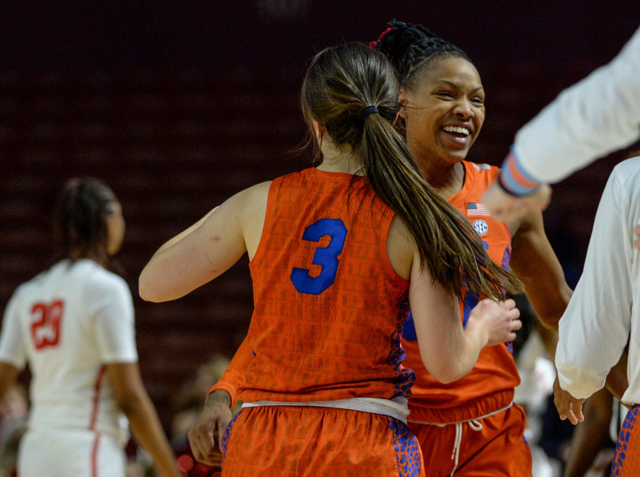 Florida guard Funda Nakkasoglu(3) and Florida guard Delicia Washington(0) celebrates a win over Ole Miss in the Southeastern Conference Women's Tournament game at Bon Secour Wellness Arena in Greenville Wednesday, March 6, 2019.
