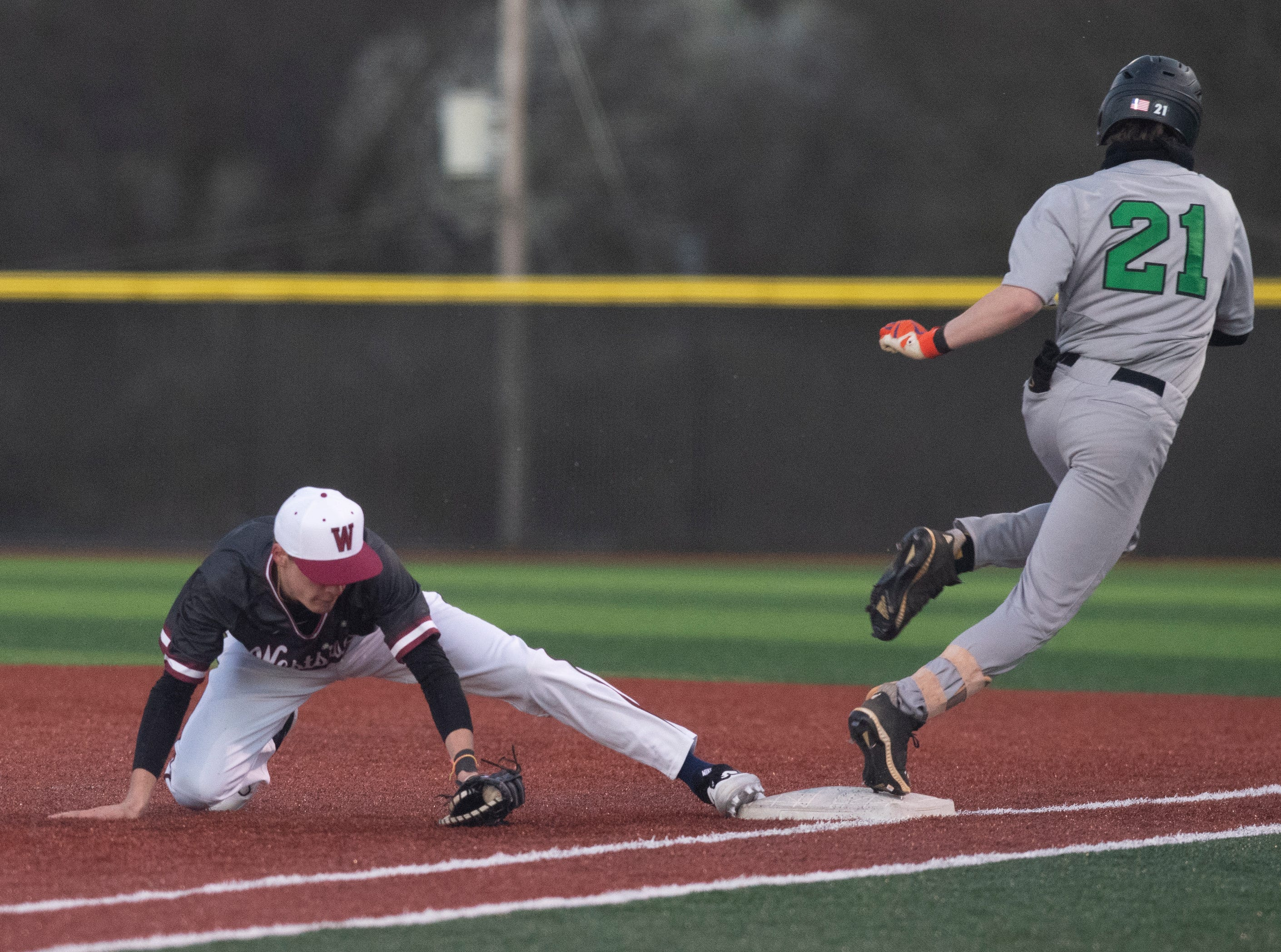 Westside High School's Nate Bailey (10) has the ball at first base forcing Easley High School's Banks Starbuck (21) out at Westside High School Tuesday, Mar. 5, 2019.