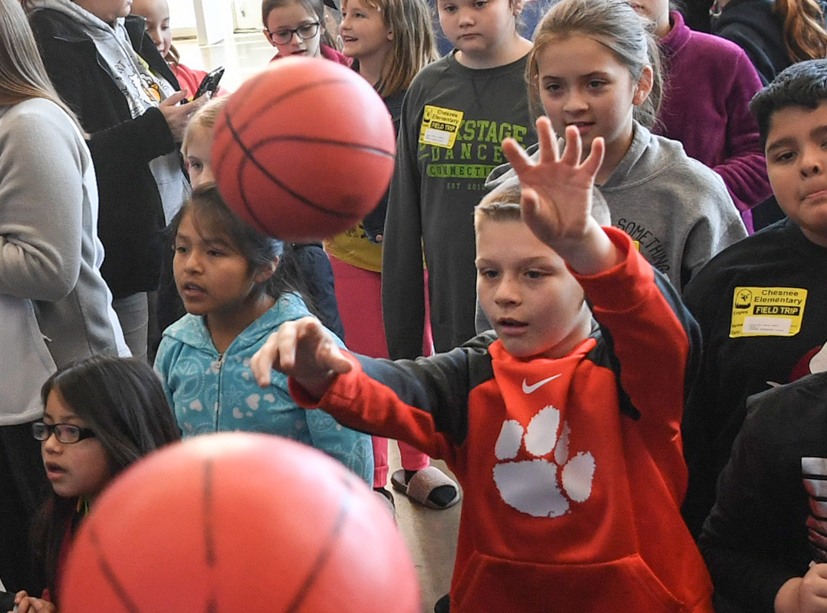 Collyn Scruggs, 9, of Chesnee Elementary shoots a basketball in the concourse of Bon Secour Wellness Arena before the first SEC Women's basketball tournament game with Ole Miss and Florida started in Greenville Wednesday. The tournament lasts through Sunday.