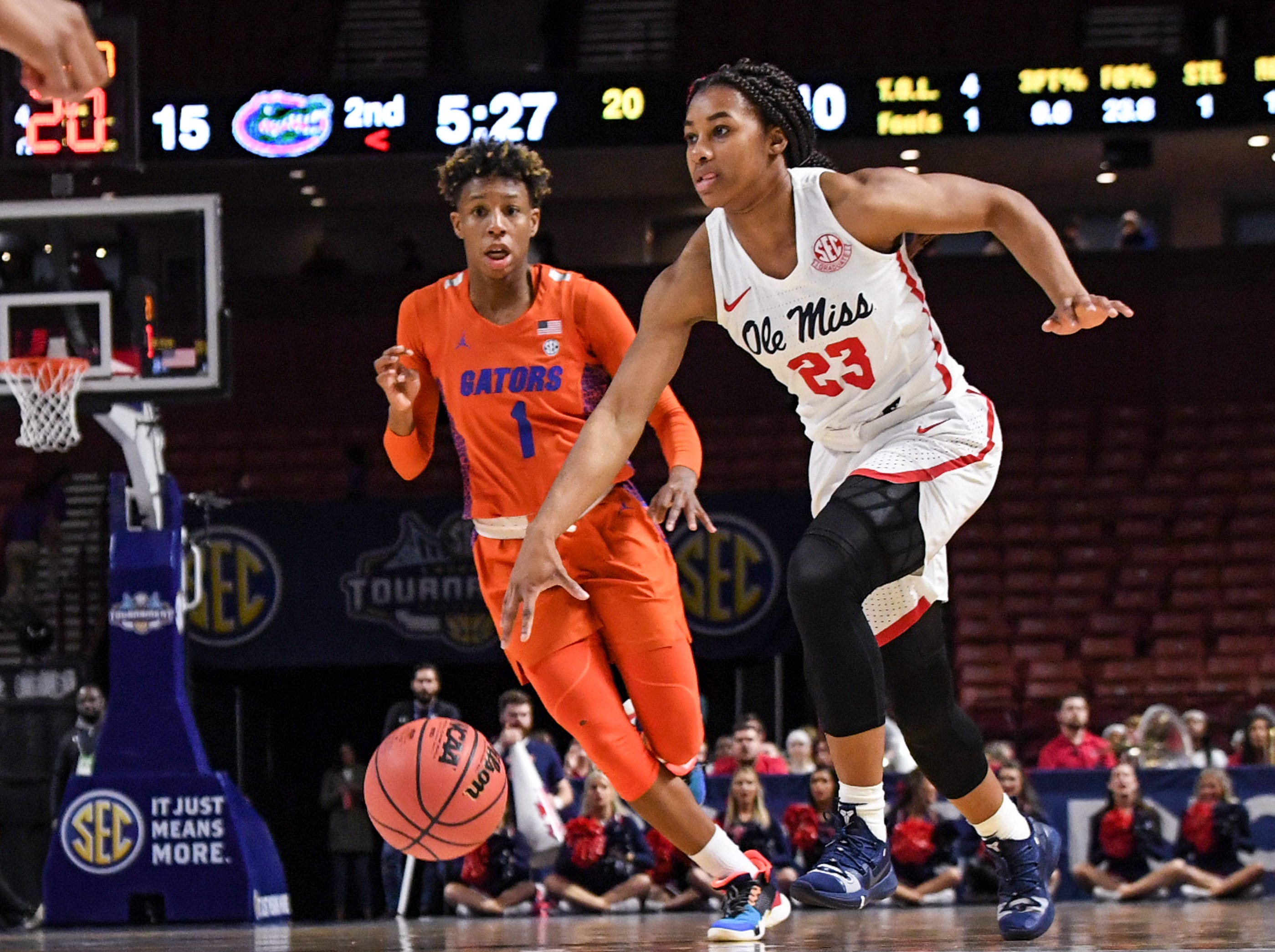 Ole Miss senior Shandricka Sessom(23) dribbles near Florida guard Kiara Smith(1) during the fourth quarter of the Southeastern Conference Women's Tournament game at Bon Secour Wellness Arena in Greenville Wednesday, March 6, 2019.