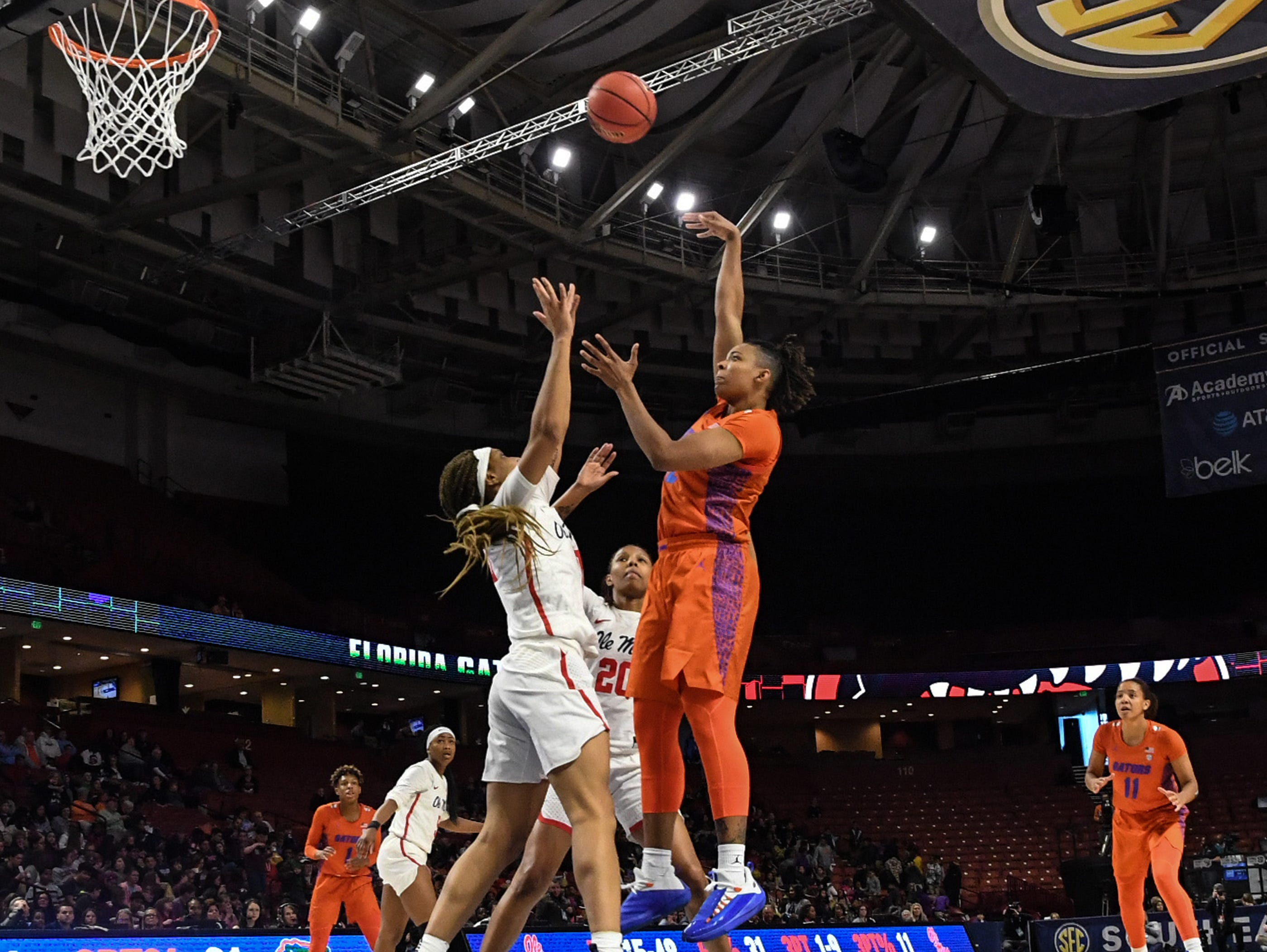 Florida forward Zada Williams shoots over Ole Miss senior Crystal Allen(5) during the fourth quarter of the Southeastern Conference Women's Tournament game at Bon Secour Wellness Arena in Greenville Wednesday, March 6, 2019.