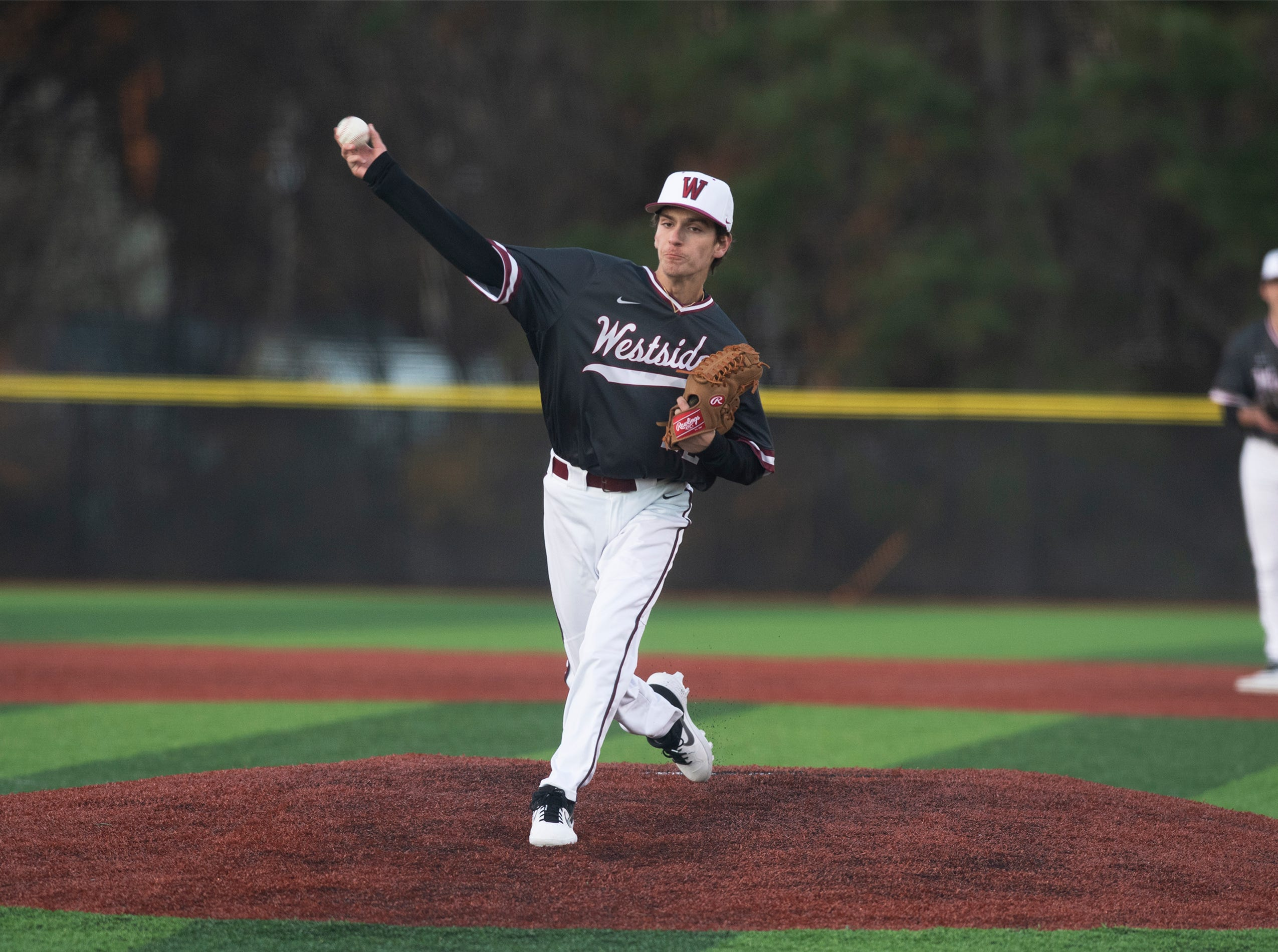 Westside High School's Connor McGill (22) pitches against Easley High School at Westside High School Tuesday, Mar. 5, 2019.