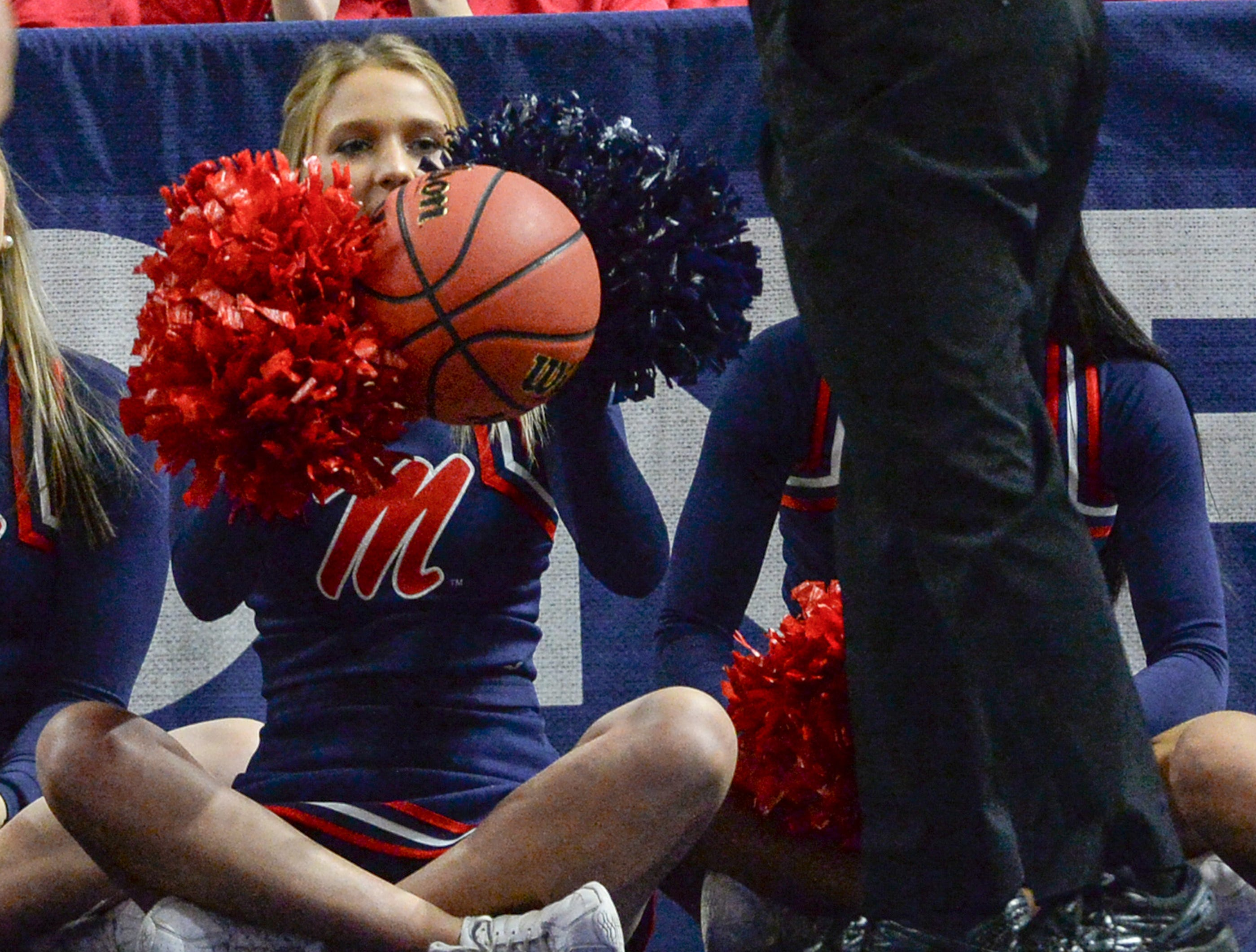 An Ole Miss cheerleader catches a loose basketball during the first SEC Women's basketball tournament game with Ole Miss and Florida started in Greenville Wednesday. The tournament lasts through Sunday.