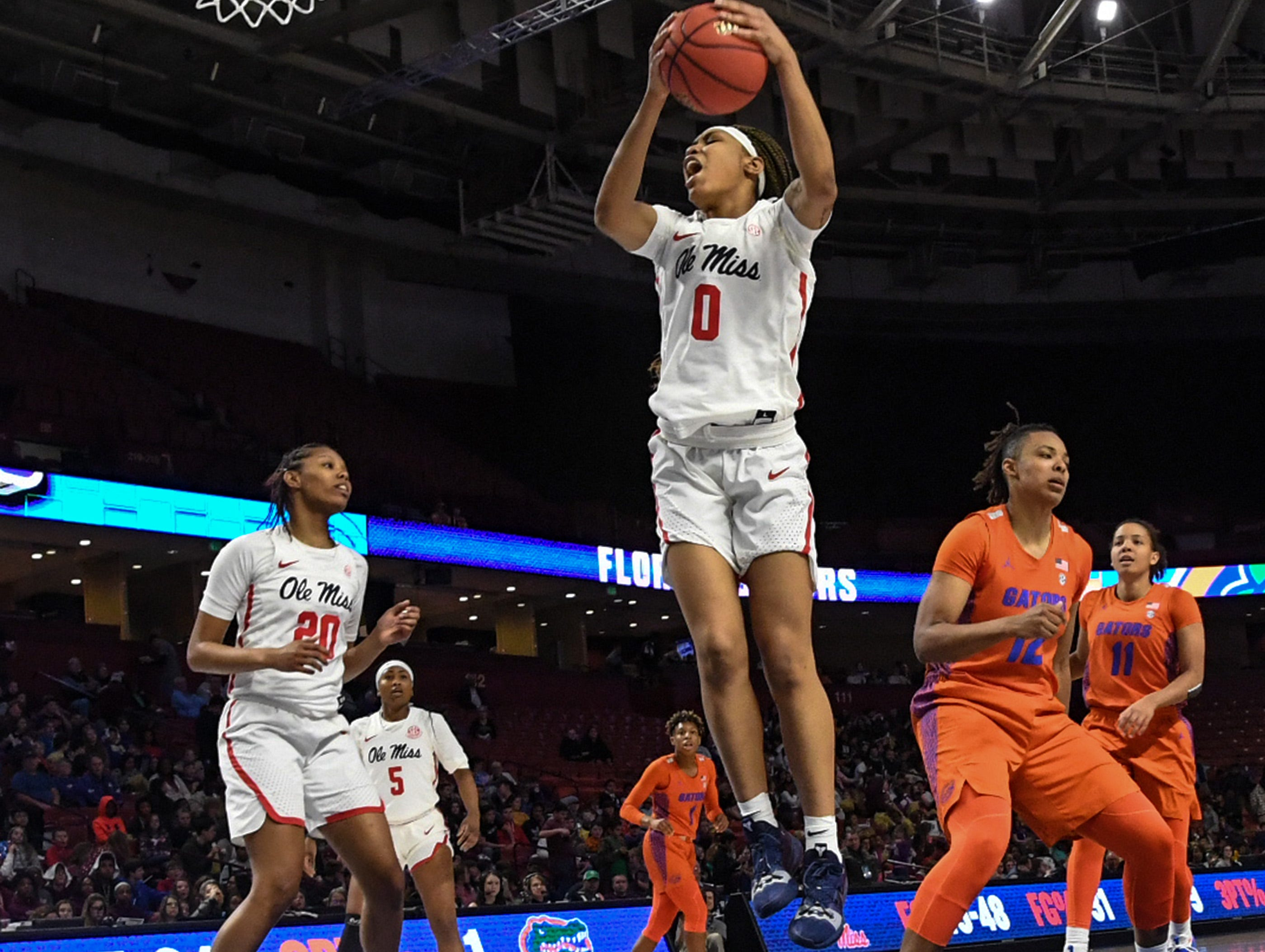 Ole Miss freshman Gabby Crawford(0) rebounds near Florida forward Zada Williams(12)during the fourth quarter of the Southeastern Conference Women's Tournament game at Bon Secour Wellness Arena in Greenville Wednesday, March 6, 2019.