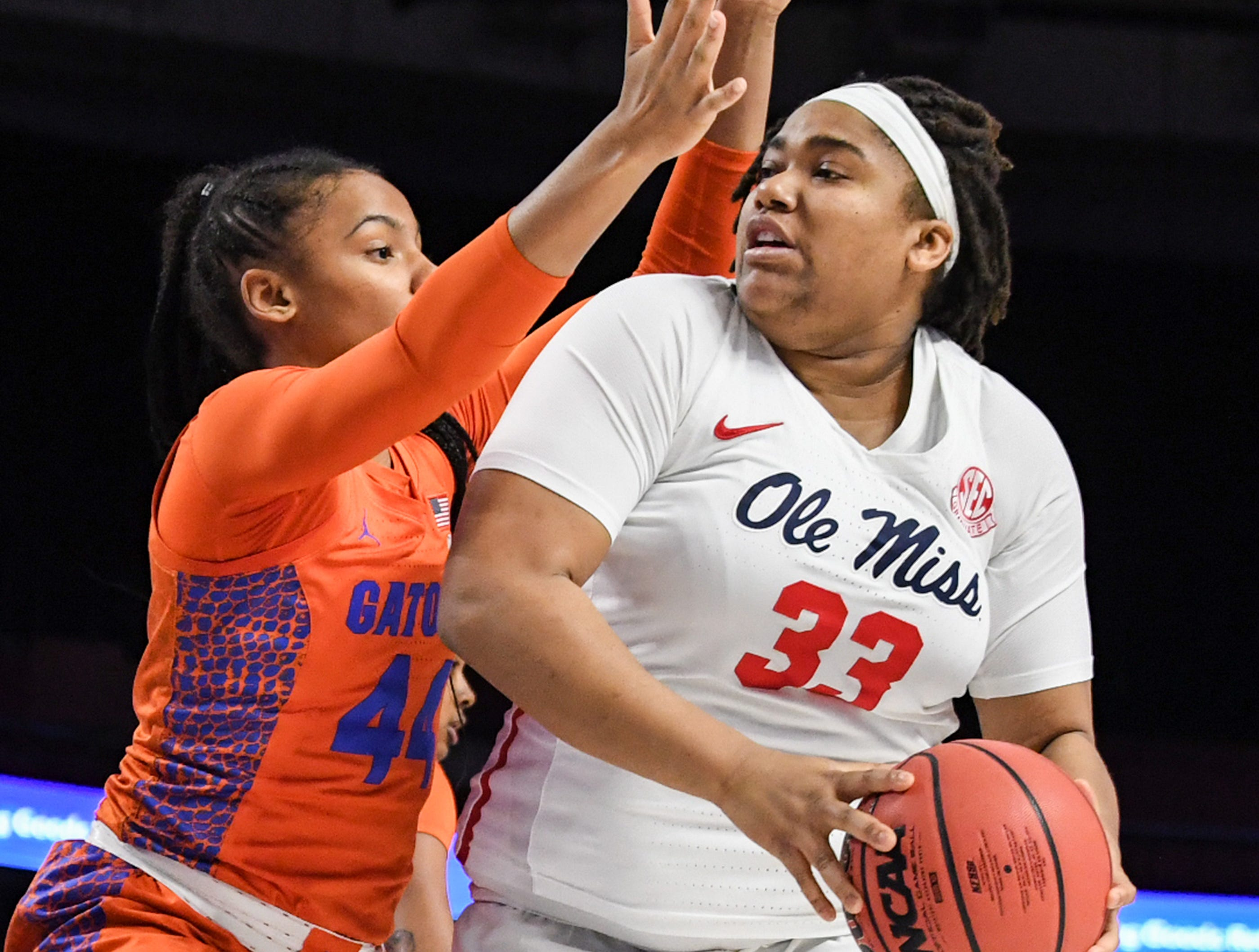 Florida forward Paige Robinson(44) pressures Ole Miss senior La'Karis Salter(33) during the fourth quarter of the Southeastern Conference Women's Tournament game at Bon Secour Wellness Arena in Greenville Wednesday, March 6, 2019.