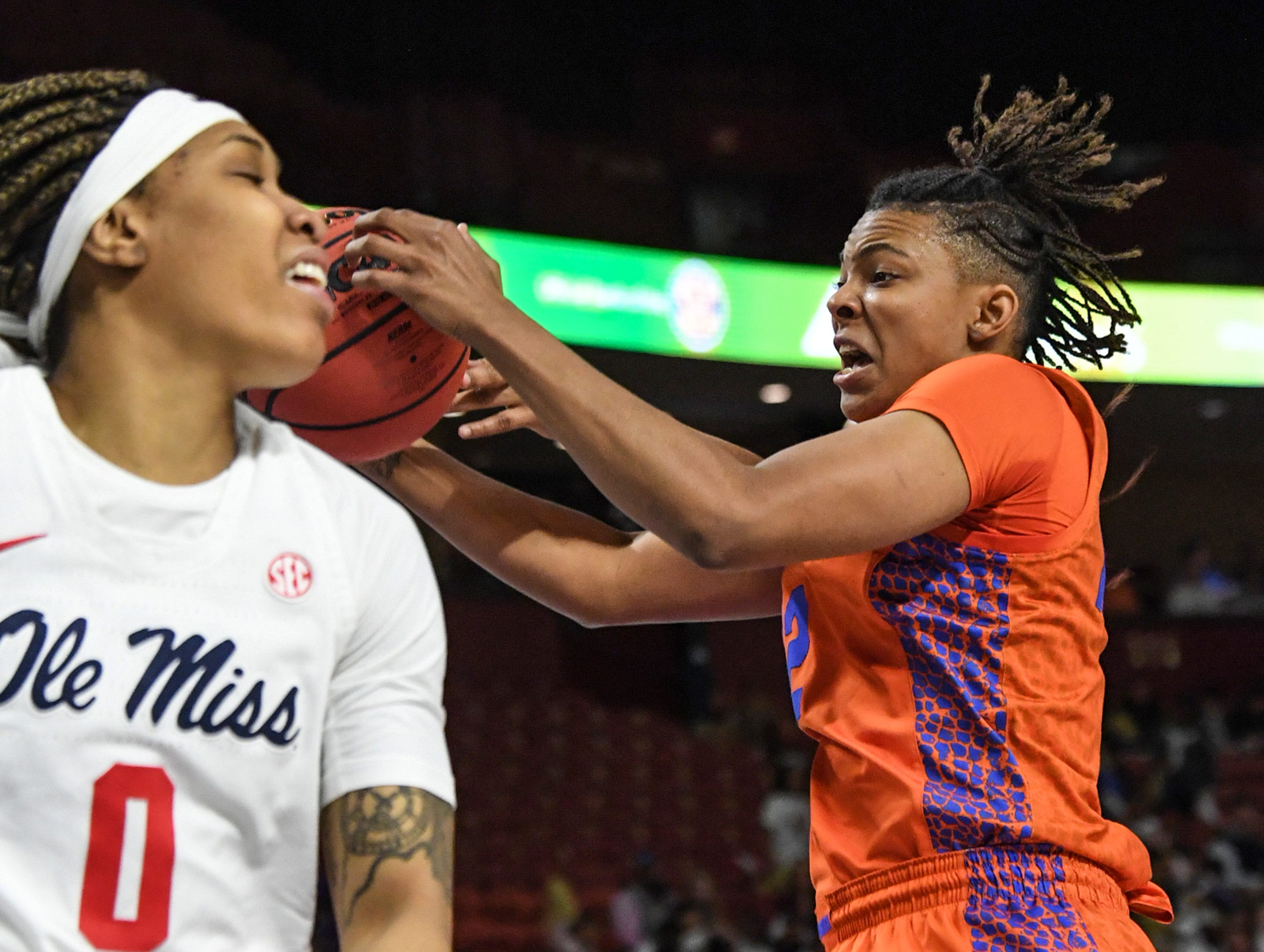 Florida forward Zada Williams rebounds near Ole Miss freshman Gabby Crawford(0) during the first quarter of the Southeastern Conference Women's Tournament game at Bon Secour Wellness Arena in Greenville Wednesday, March 6, 2019.