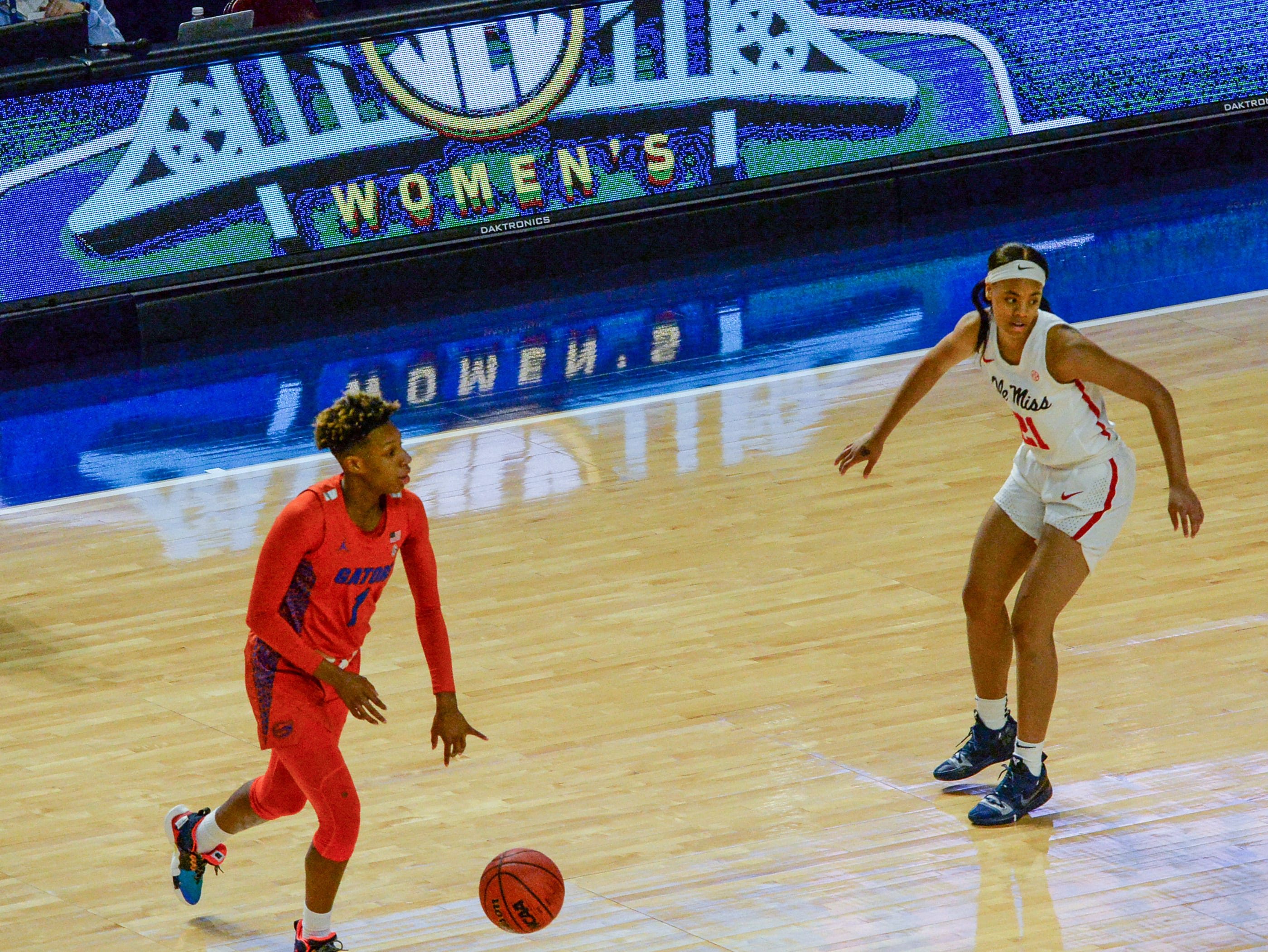 Florida guard Kiara Smith(1) dribbles near Ole Miss freshman Taylor Smith(21) during the first quarter of the Southeastern Conference Women's Tournament game at Bon Secour Wellness Arena in Greenville Wednesday, March 6, 2019.