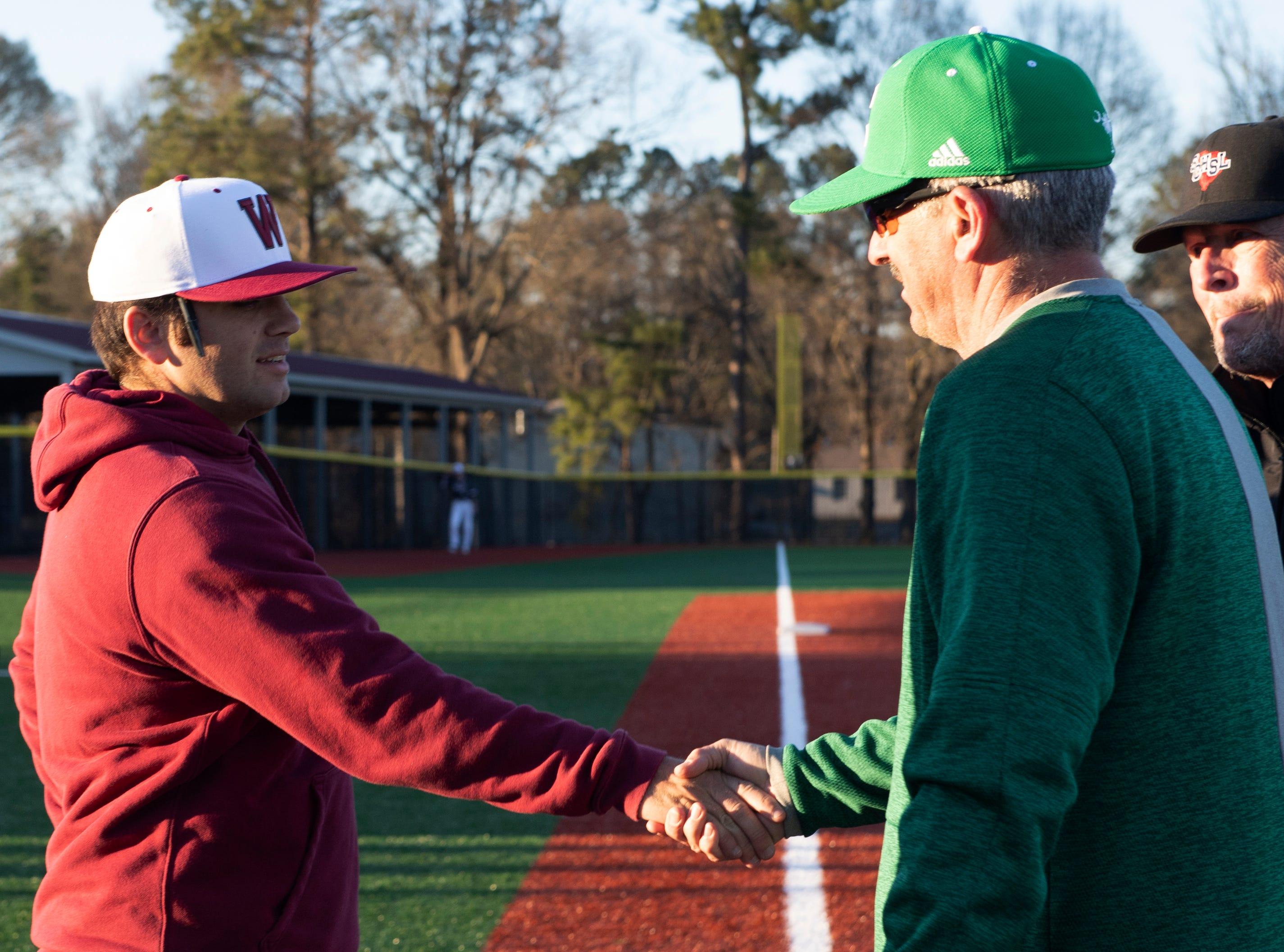 Westside High School head coach Jarrod Payne (left) and his father Easley High School head coach Gill Payne shake hands before the start of their game at Westside High School Tuesday, Mar. 5, 2019.