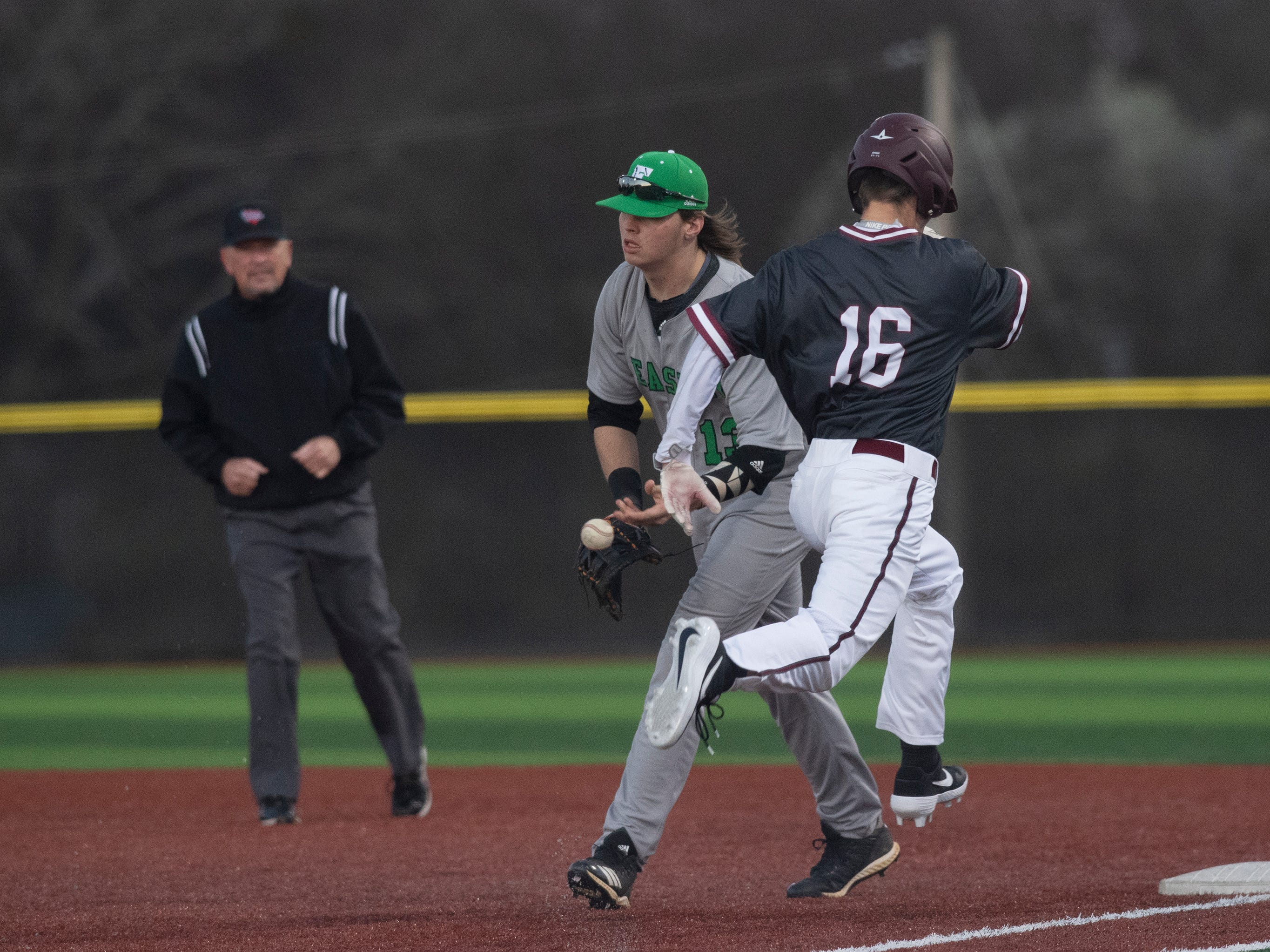 Easley High School's Stokes O'Shields (13) throws the ball after forcing Westside High School's Eli Morrison (16) out and ending the inning at Westside High School Tuesday, Mar. 5, 2019.