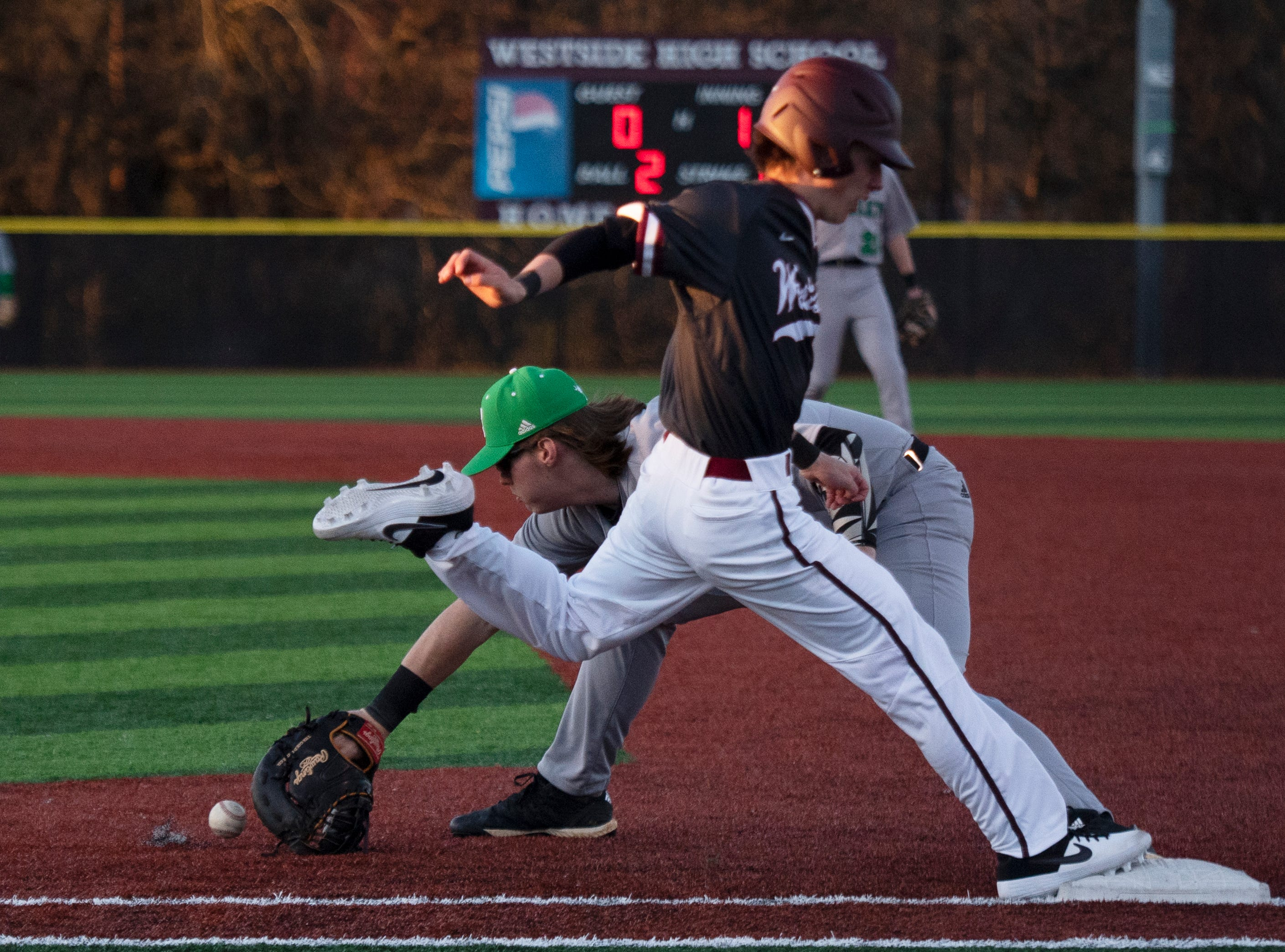Westside High School's Cade Langston (7) is safe at first base as Easley High School's Stokes O'Shields (13) reaches for the ball at Westside High School Tuesday, Mar. 5, 2019.