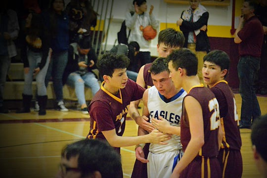 Poplar players approach a disappointed Ryder Meyer of Fairfield following a semifinal game last weekend at the Northern B tournament in Shelby. Poplar won on a last-second shot in overtime, after which the team displayed exceptional sportsmanship in this classy gesture.