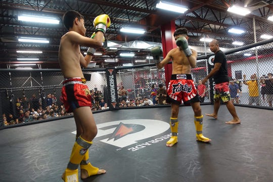 Kyle Palma and Kris Quitano of Guam Muay Thai trade blows in an exhibitoin Muay Thai bout at Steel Athletics' Glorified Sparring event on March 1st, held to raise money for the Tamuning Skatepark.
