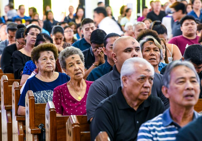 Crosses marked with ash adorn the foreheads of many during an Ash Wednesday Mass at the St. Anthony of Padua-St. Victor Catholic Church in Tamuning on March 6, 2019.