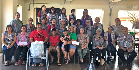 """The Guam Sunshine Lions Club, in keeping with its mission of """"Caring for the sick and the elderly,"""" made monetary donations to Ricardo S. Santos, 82, of Santa Rita and Ekika Concepcion, 22, of Mangilao, to assist with their medical treatment expenses.  A bedside commode and hygiene supplies were also donated to Juan B. Mesa, 68, of Barrigada.  Lion Marietta Camacho, seated, second from left, accepted donation on behalf of Santos.  John Paul Fejeran, seated, third from left accepted donation on behalf of Mesa; and Lion Dot Leon Guerrero, seated, seventh from left, accepted donation on behalf of Concepcion. Presentations were made at the Chamoru Village in Hagåtña on March 2."""