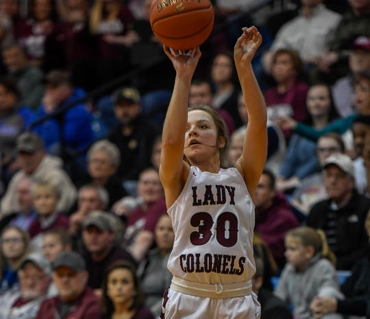 Henderson County's Emilee Hope (30) shoots a three point attempt as the Webster County Lady Trojans play the Henderson County Colonels for the Girls Second Region Championship at the Rocket Arena in Marion Tuesday, March 5, 2019.