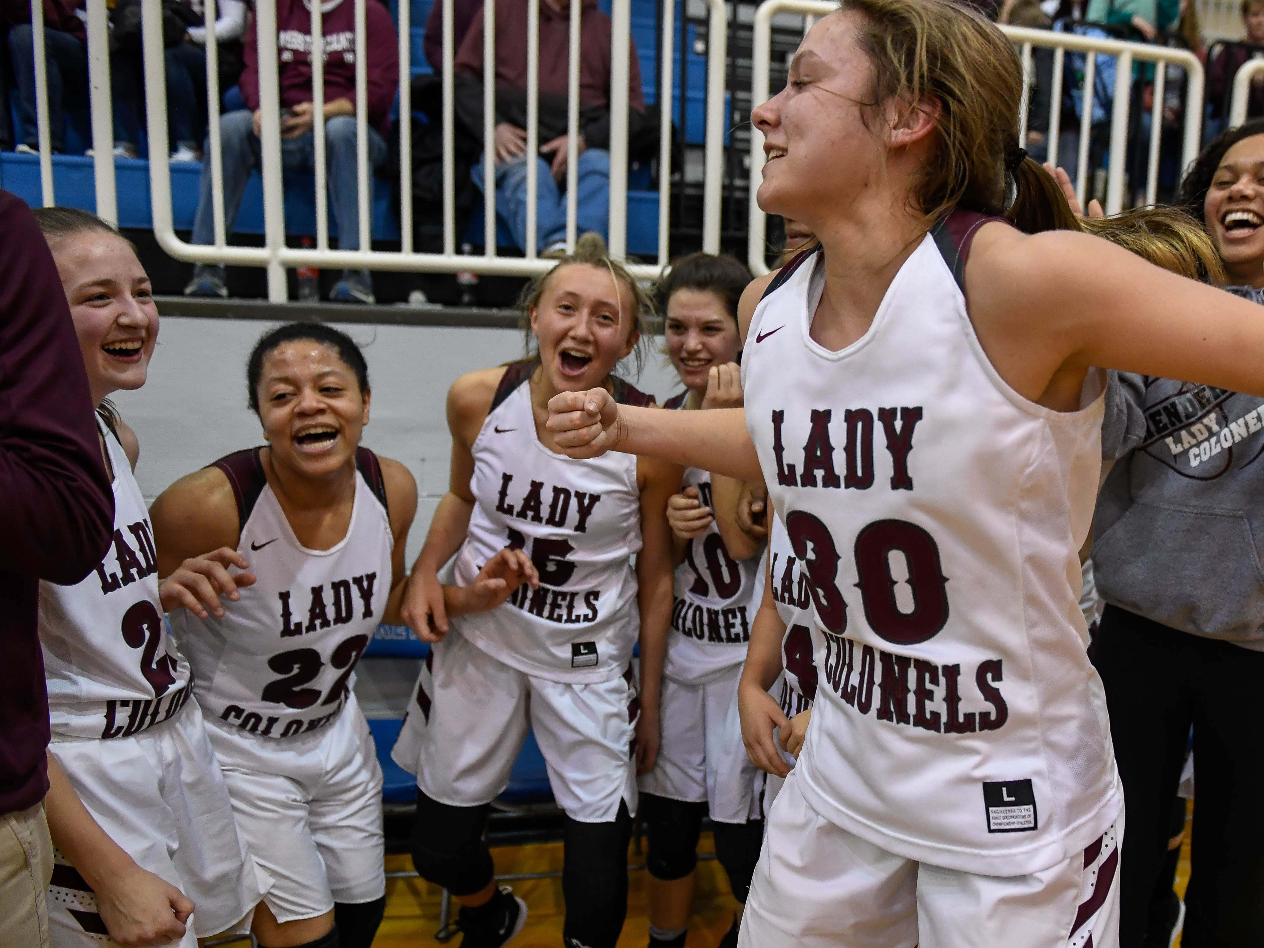 The Lady Colonels erupt as victory nears in the Girls Second Region Championship as Henderson defeats the Webster County Lady Trojans at the Rocket Arena in Marion Tuesday, March 5, 2019.
