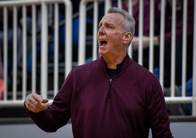 Henderson County Head Coach Jeff Haile yells instructions to his team as the Webster County Lady Trojans play the Henderson County Colonels for the Girls Second Region Championship at the Rocket Arena in Marion Tuesday, March 5, 2019.