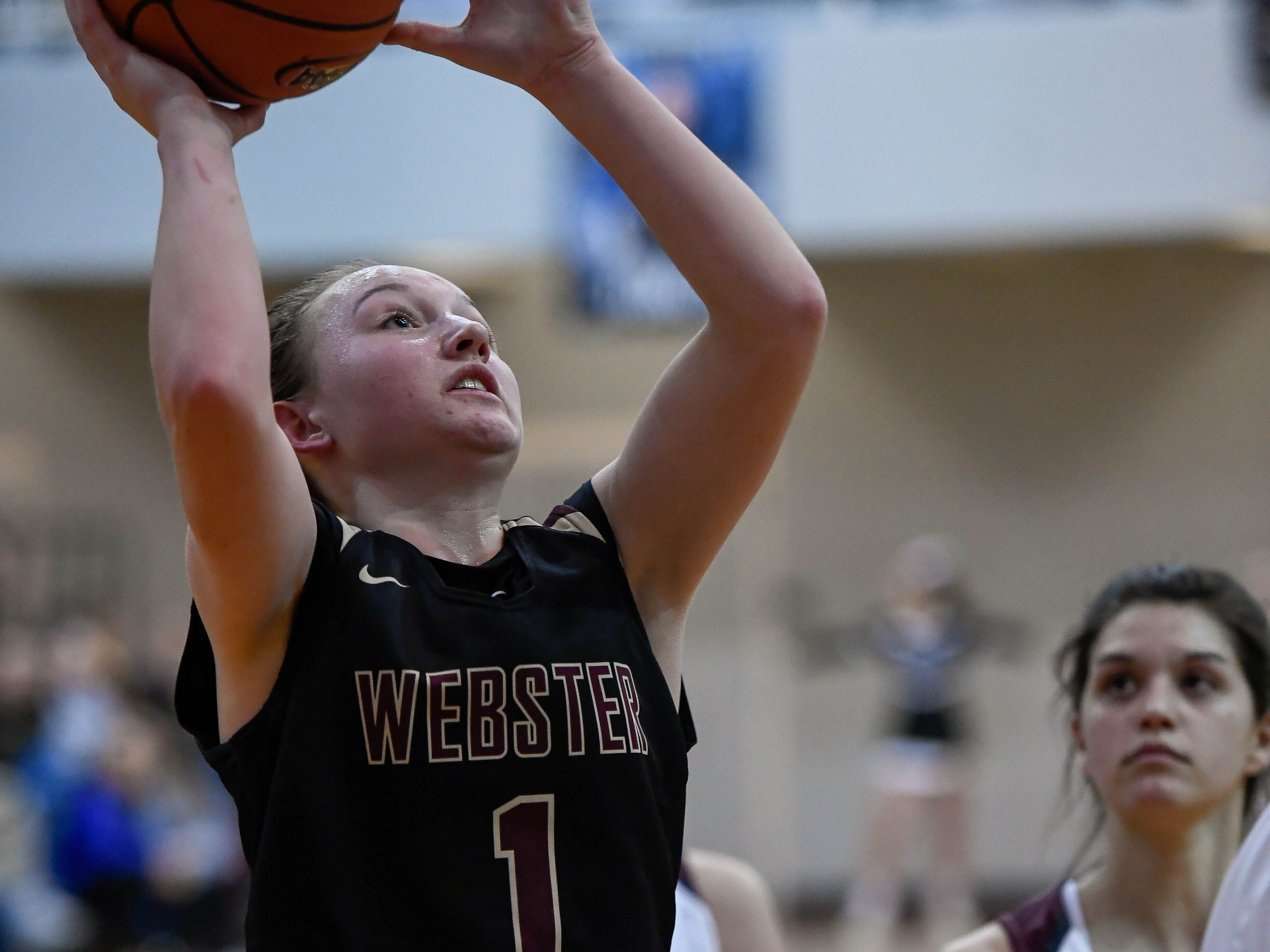 Webster County's Sadie Wurth (1) takes a shoot at the basket as the Webster County Lady Trojans play the Henderson County Colonels for the Girls Second Region Championship at the Rocket Arena in Marion Tuesday, March 5, 2019.