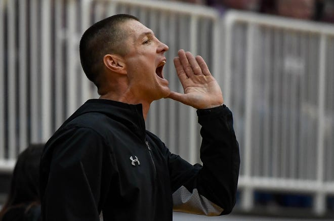 Webster County head coach Brandon Fisher yells to his team as the Webster County Lady Trojans play the Henderson County Colonels for the Girls Second Region Championship at the Rocket Arena in Marion Tuesday, March 5, 2019.