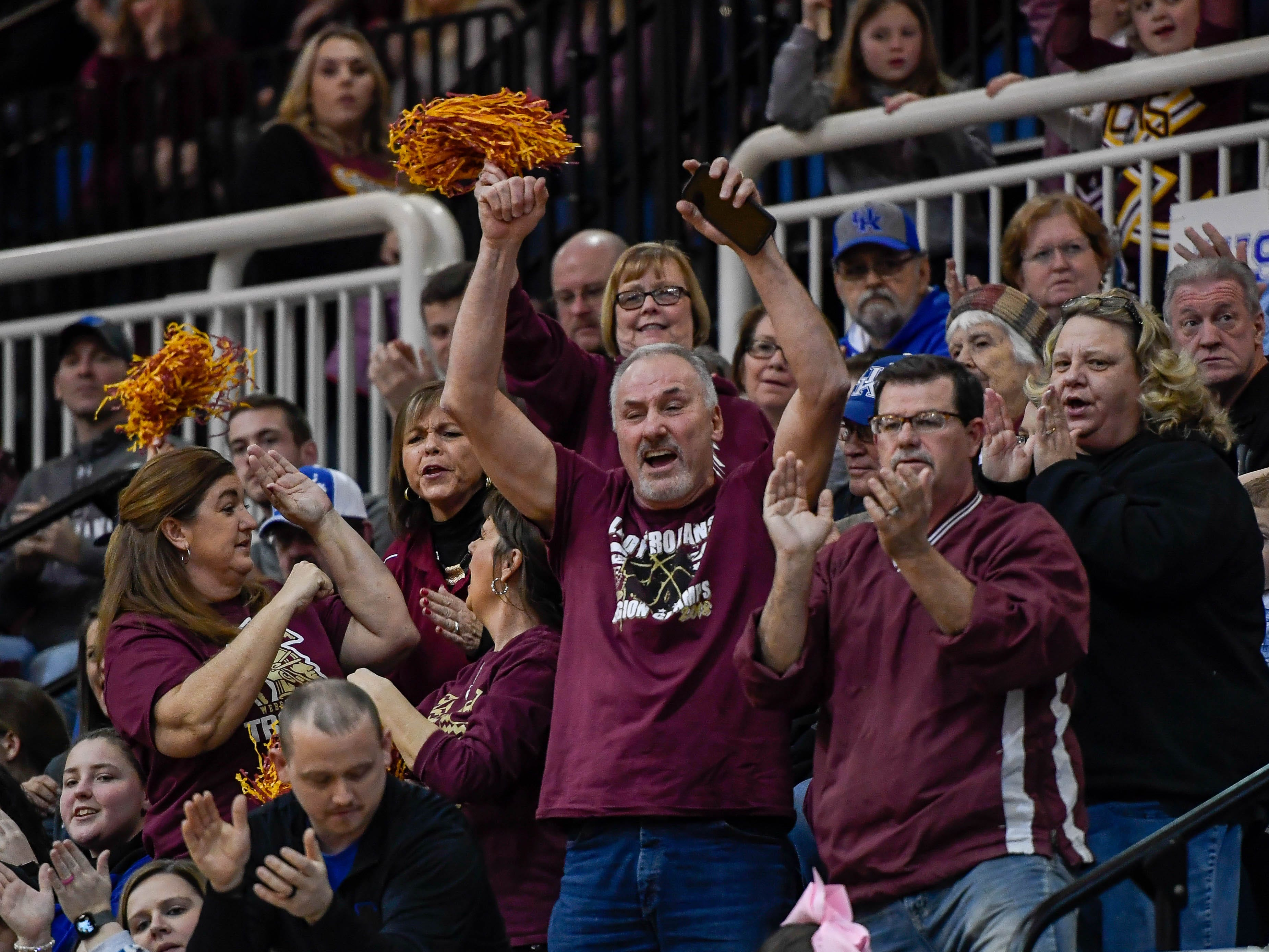 Fans cheer a Webster rally as the Webster County Lady Trojans play the Henderson County Colonels for the Girls Second Region Championship at the Rocket Arena in Marion Tuesday, March 5, 2019.