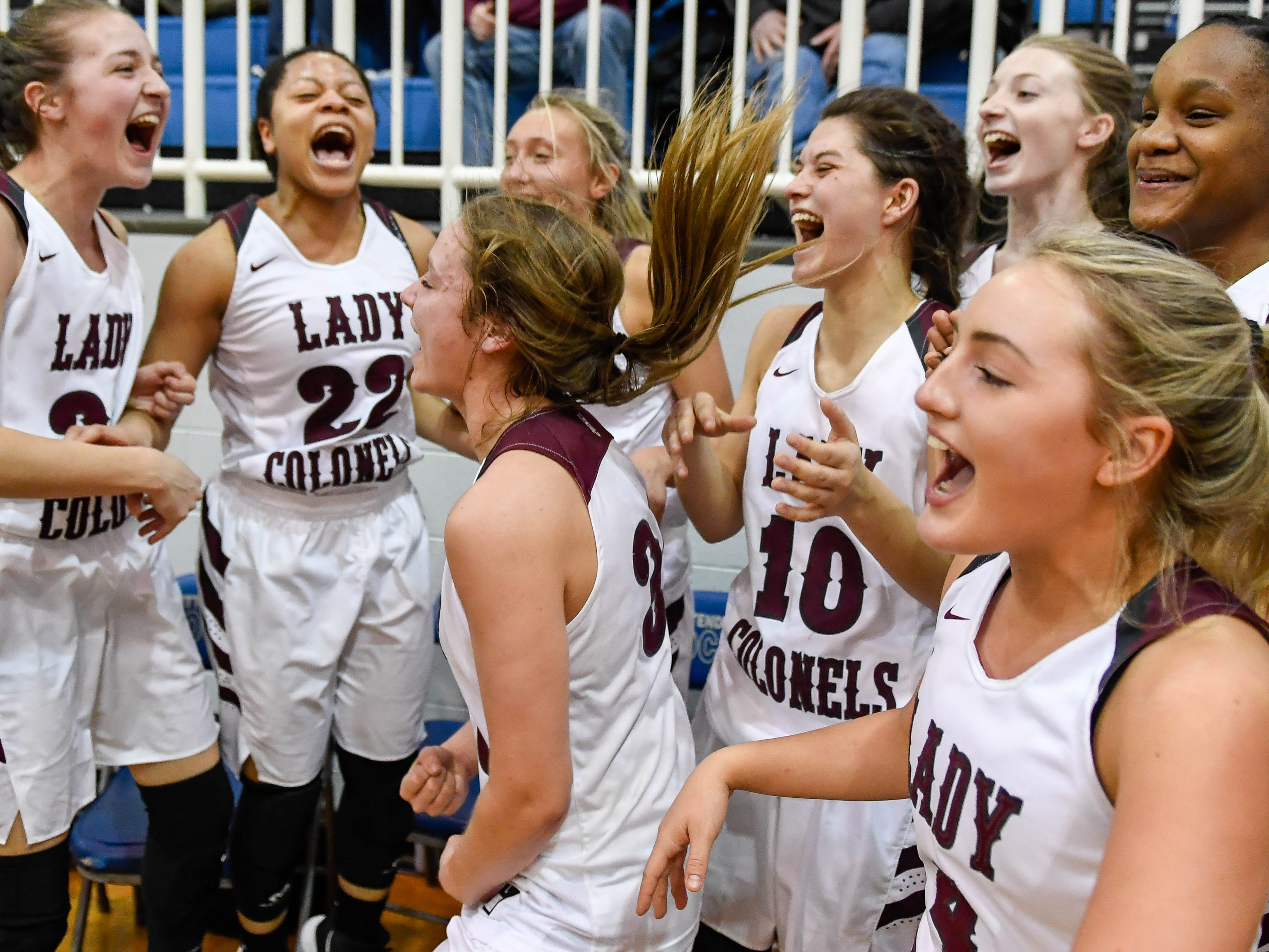 The Henderson County Colonels celebrate their victory over the Webster County Lady Trojans in the Girls Second Region Championship at the Rocket Arena in Marion Tuesday, March 5, 2019.