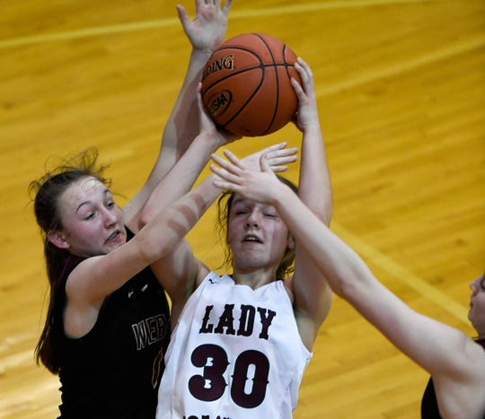 Henderson County's Emilee Hope (30) tries to shoot through defensive pressure as the Webster County Lady Trojans play the Henderson County Colonels for the Girls Second Region Championship at the Rocket Arena in Marion Tuesday, March 5, 2019.