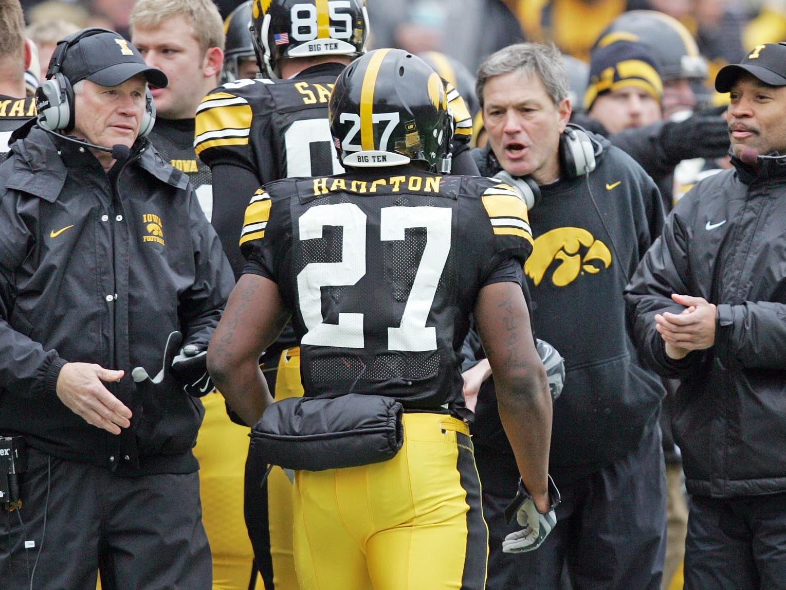 From 2008: assistants Reese Morgan, left and Erik Campbell, right, join coach Kirk Ferentz in welcoming Jewel Hampton to the sideline after his 22-yard touchdown run in the first quarter against Purdue.