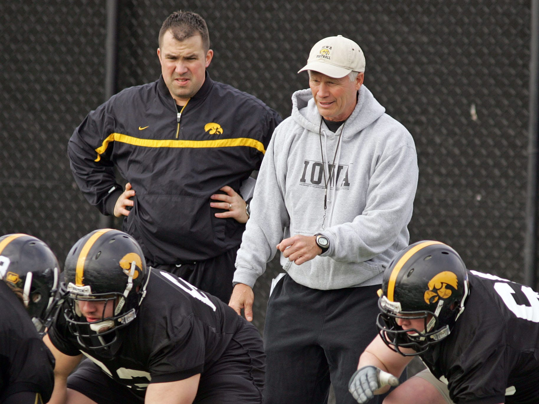 From 2008: Iowa graduate assistant Dan Clark, left, watches offensive line coach Reese Morgan direct a drill during practice.