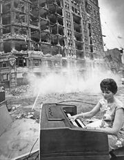"Organist Martha Waltz, dressed in Polynesian garb, was one of the organists stationed at the site to play ""music to demolish by,"""
