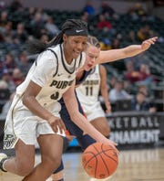 Lyndsey Whilby of the Purdue Boilermakers works around pressure from Illinois, during action at Bankers Life Fieldhouse, Indianapolis, Wednesday, March 6, 2019. Purdue won 72-60 in the first round of the Women's Big Ten Basketball Tournament.