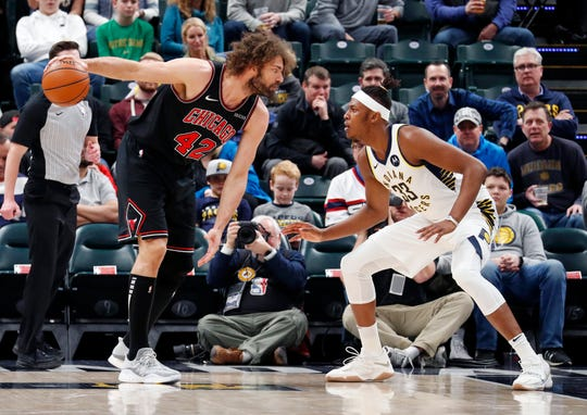 Mar 5, 2019; Indianapolis, IN, USA; Chicago Bulls center Robin Lopez (42) is guarded by Indiana Pacers center Myles Turner (33) during the first quarter at Bankers Life Fieldhouse.