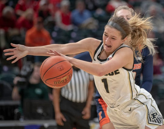 Karissa McLaughlin of the Purdue Boilermakers is fouled as she drove to the basket during this play against Illinois, Bankers Life Fieldhouse, Indianapolis, Wednesday, March 6, 2019. Purdue won 72-60 in the first round of the Women's Big Ten Basketball Tournament.