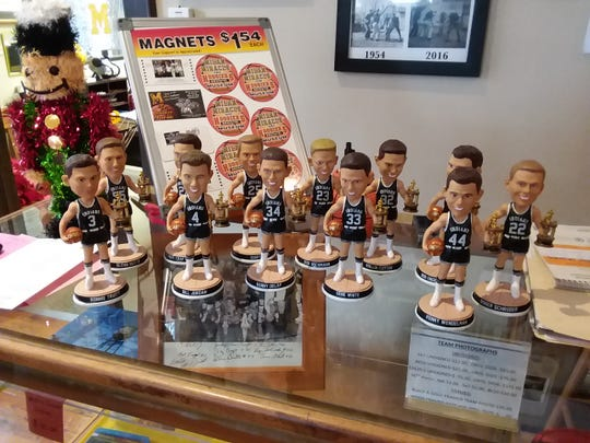 Bobbleheads of the 1954 Milan Indians, who won the boys basketball state championship and eventually inspired the movie 'Hoosiers.'