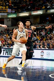 Mar 5, 2019; Indianapolis, IN, USA; Indiana Pacers forward Bojan Bogdanovic (44) drives to the basket against Chicago Bulls forward Otto Porter Jr. (22) during the first quarter at Bankers Life Fieldhouse.