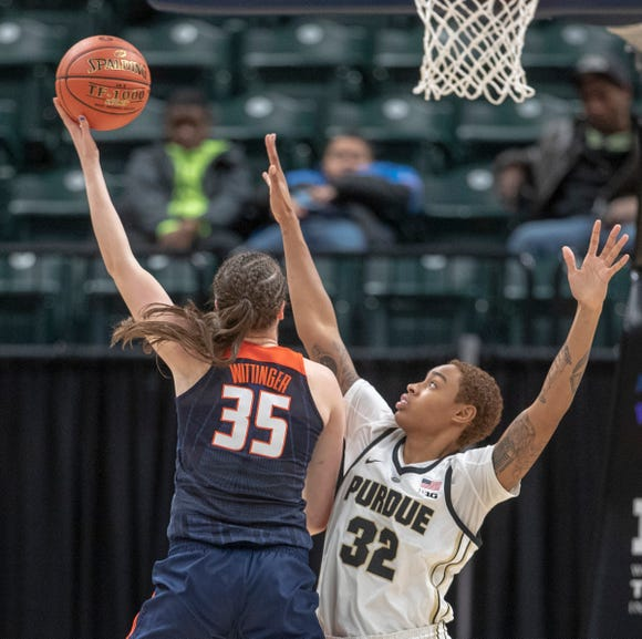 Alex Wittinger of the Illinois Fighting Illini puts up a shot on Ae'Rianna Harris of the Purdue Boilermakers, Bankers Life Fieldhouse, Indianapolis, Wednesday, March 6, 2019. Purdue won 72-60 in the first round of the Women's Big Ten Basketball Tournament.
