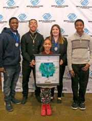 D'sjon Perkins (from left), Elijah Leonard, Ariel Holmes, Clara Oesterling and Christian Herron are honored at the Boys & Girls Club Youth of the Year award ceremons.