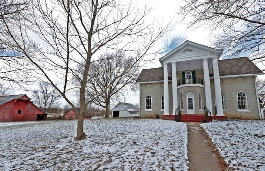 This Hot Property is an Bargersville farmhouse built in 1866, seen Tuesday, March 5, 2019.  This 1866 home at 3810 W 100, in Bargersville, includes several structures, like a barn built in 1901, at left, on the 7 acres.