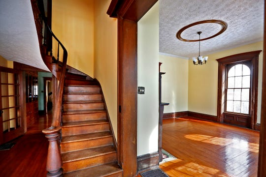 This Hot Property is an Bargersville farmhouse built in 1866, seen Tuesday, March 5, 2019.  A beautiful staircase rises in the front entryway.  Hardwood floors, high ceilings, and arched windows are seen throughout the first floor.