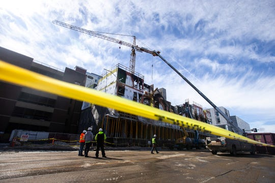 Workers begin to take down fire damage at the Hieronymus Square construction site on Wednesday, March 6, 2019, at 314 S. Clinton Street in downtown Iowa City, Iowa.
