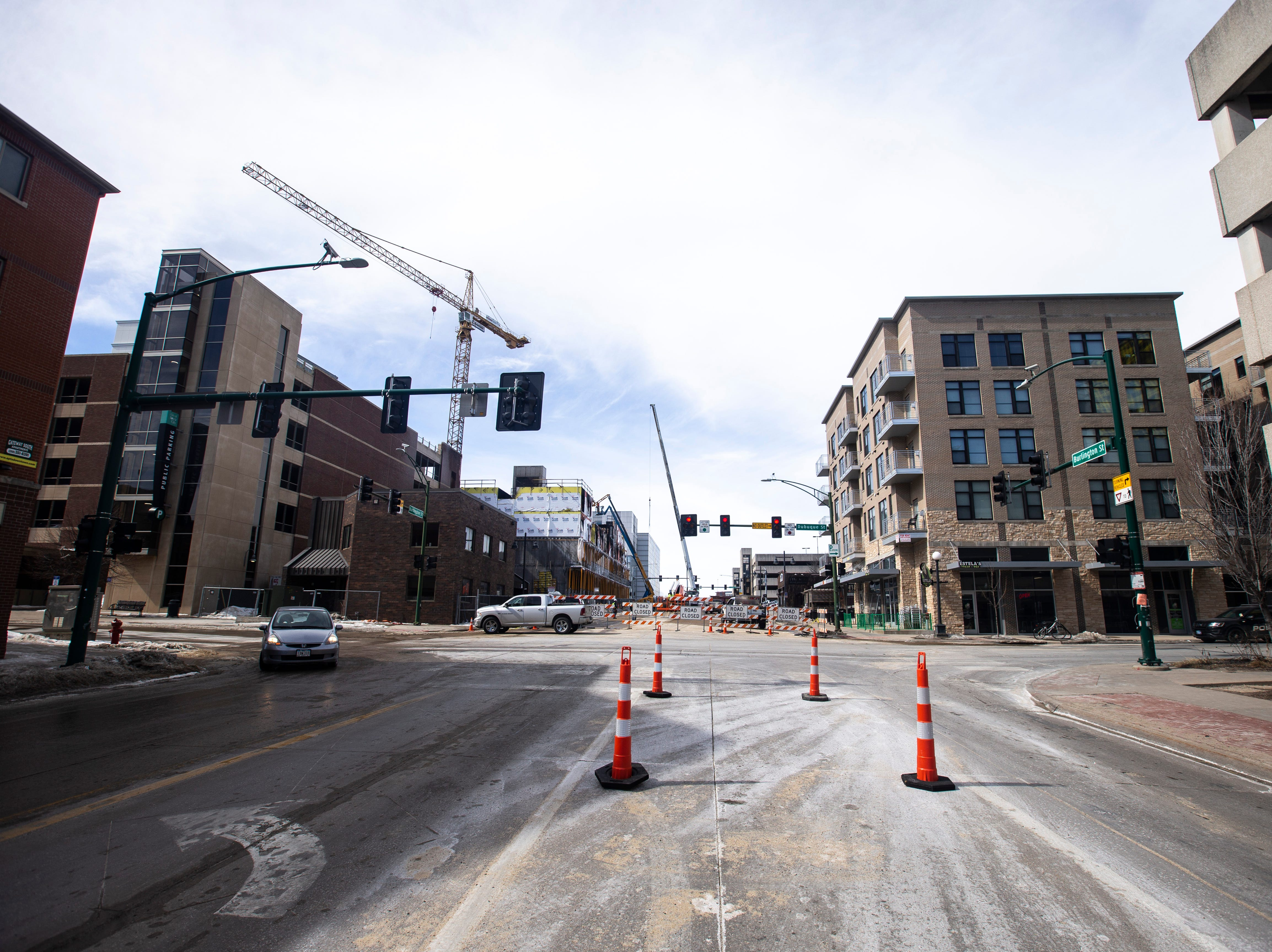 Signs block the road between Dubuque and Clinton streets as workers begin to take down fire damage at the Hieronymous Square construction site on Wednesday, March 6, 2019, at 314 S. Clinton Street in downtown Iowa City, Iowa.