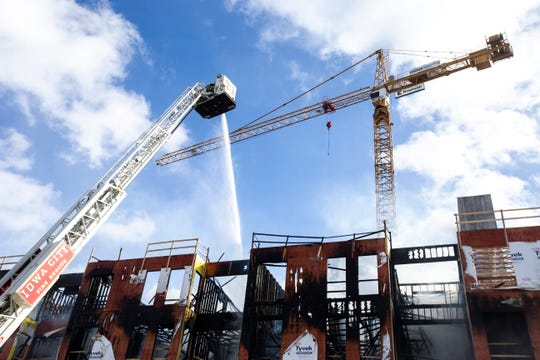 Fire crews work after a blaze erupted at the Hieronymous Square construction site on Tuesday, March 5, 2019, at 314 S. Clinton Street in downtown Iowa City, Iowa.