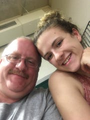 Kelly Perkins and her father, Enoch Perkins.