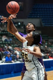Olive Branch Endya Buford (25) battles with Hattiesburg's Kenedi Walker for a rebound during the MHSAA 5A Girls Basketball Championship Semi Finals held at the Mississippi Coliseum in Jackson, MS, Tuesday March 5th, 2019.(Bob Smith-For the Clarion Ledger)