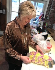 Susan Schneeflock of Madison, a Realtor with ERA Real Estate Professionals, looks at cookies at Olivia's Food Emporium in Ridgeland.