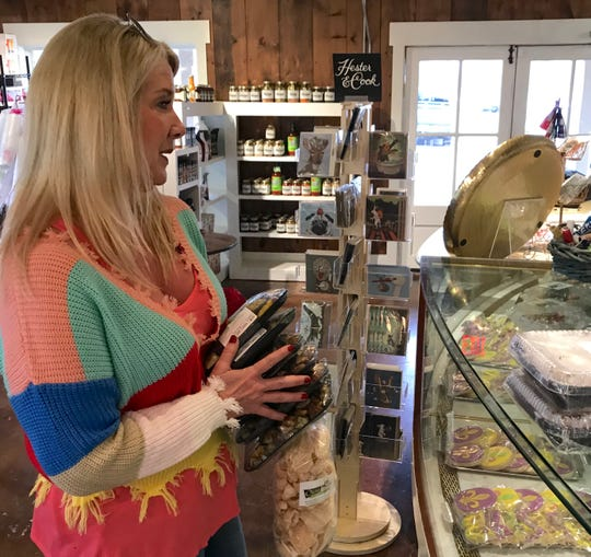 Christy Outlaw of Madison purchases several ready-to-heat items at Olivia's Food Emporium in Ridgeland.