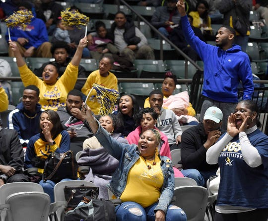 Olive Branch fans cheer for the Conquistadors in a semifinal game of the MHSAA C Spire State Basketball Championships at the Mississippi Coliseum in Jackson, Miss., on Tuesday, March 5, 2019.