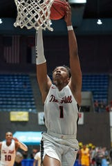Center Hill's Decorian Payton (1) goes to the basket against Hattiesburg  during the MHSAA 5A Boys Basketball semifinals held at the Mississippi Coliseum in Jackson, Mississippi on March 5, 2019.