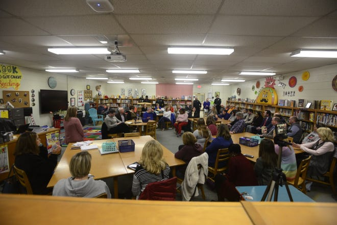 Members of Pope Elementary School's PTO listen to four members of the JMCSS Board discuss issues involving the building of a new Pope school on March 5, 2019.