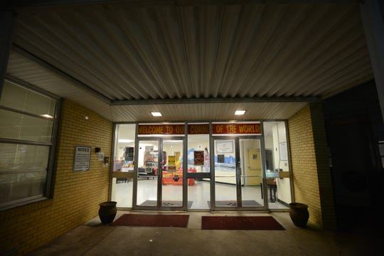 The entrance to Pope Elementary School is lit from the inside after the end of Tuesday night's PTO meeting.