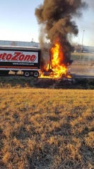 The AutoZone truck Quinn Boone was driving burns on the shoulder of Interstate 40 Wednesday morning.